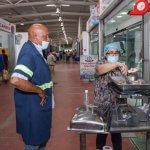 Comerciantes del Merca Santo Domingo incentivan consumo de carne de cerdo con degustación gratuita